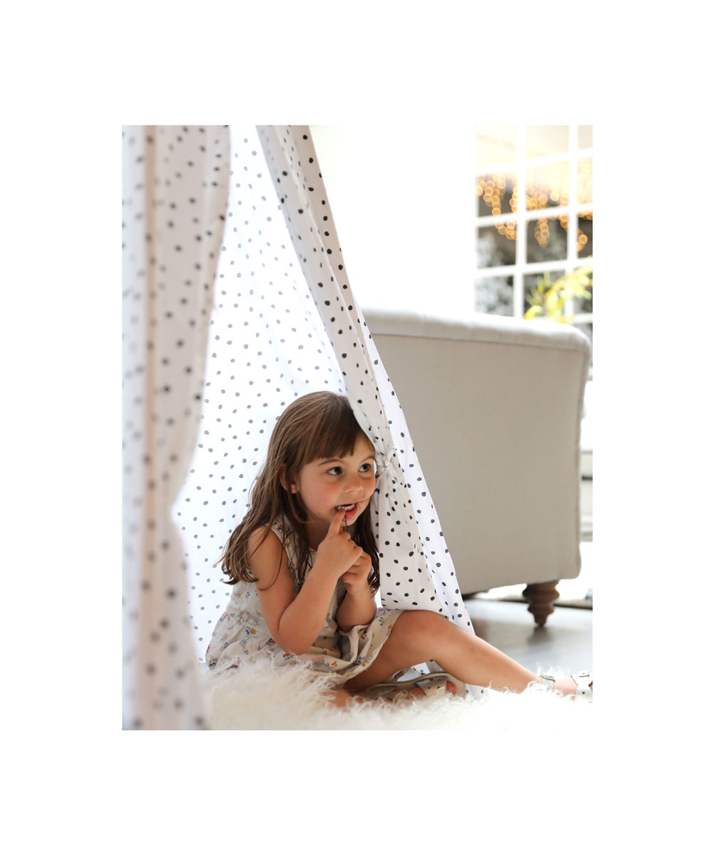 girl peeking teepee cox and cox interiors photography by brittany hurdle beckon
