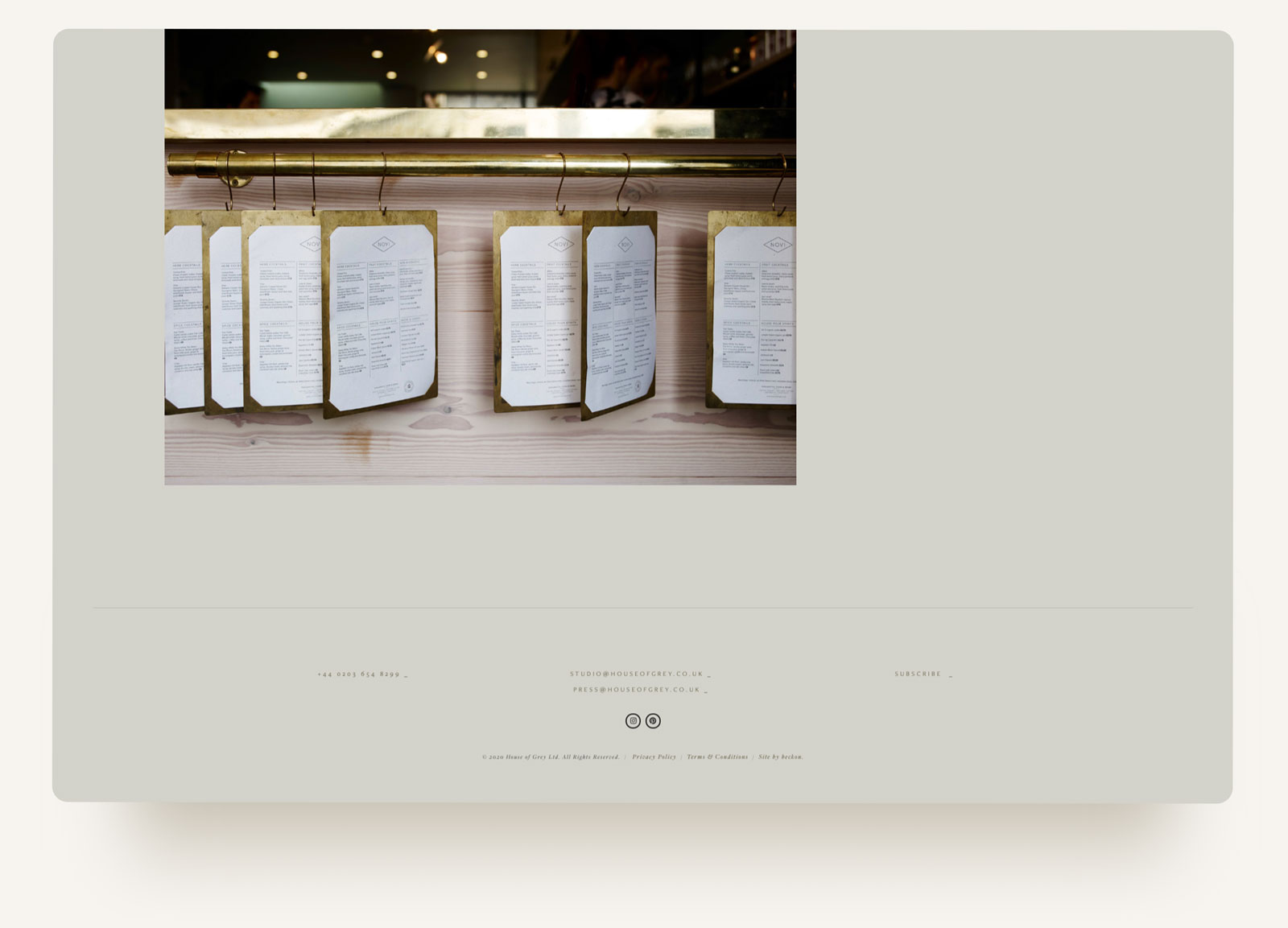 House of Grey restaurant design, brass menus and brass bar in Squarespace website design by Brittany Hurdle beckon webeeckon